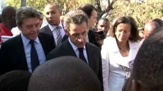 Sarkozy Makes Aid Pledge On Historic Haiti Trip