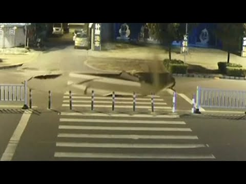 Man on a scooter plunges into sinkhole