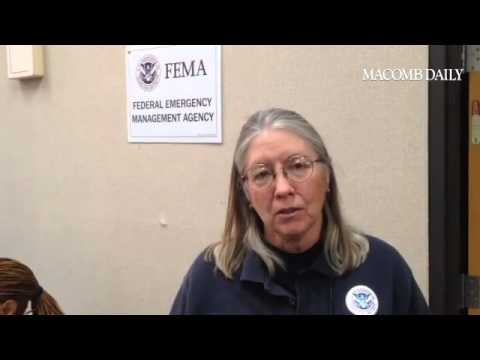 Rita Egan at FEMA's Warren disaster center on the importance of flooding victims registering for fed