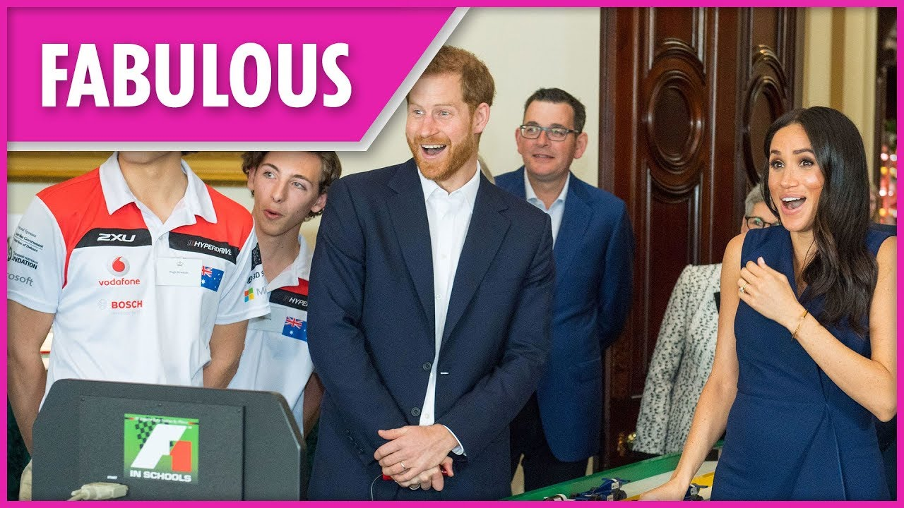 Pregnant Meghan Markle jumps in fright racing toy F1 cars in Melbourne