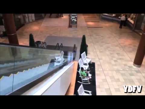 Chinese guy slides down the escalator!