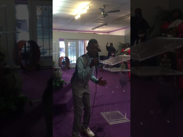 Young Man Sings Something About The Name Of Jesus.