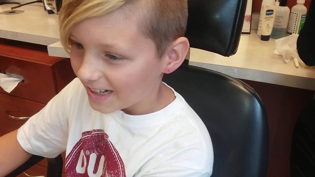 Parents let 10 year old boy get ear pierced. - YouTube