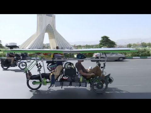 France to China solar bike cyclists attract attention in Tehran