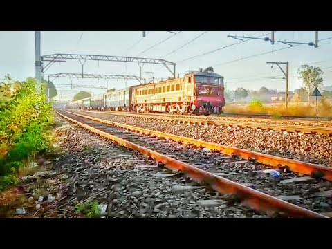 Pune Mumbai Sinhagad express shining under first rays of Sun, skipping TGN at moderate speed