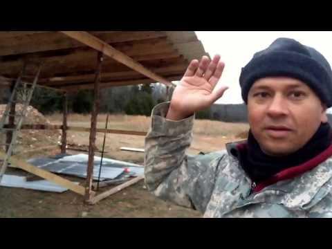 John showing outdoor garage workshop project providing shelter for stuff at off grid homesteading