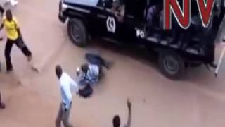 Uganda opposition supporter #FDC being kicked to near death