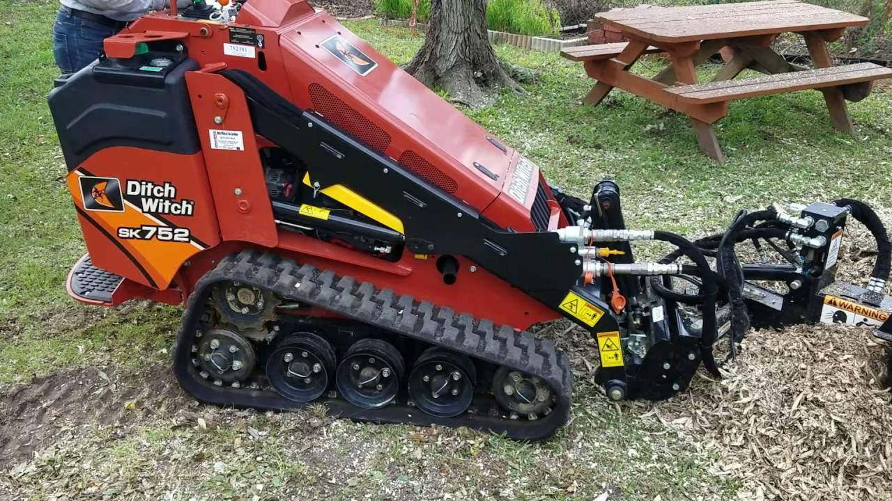 erskine mini stump grinder attachment on ditch witch sk752 mini skid steer [ 1280 x 720 Pixel ]