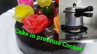 Baked  Eggless spongy Chocolate Cake in Pressure Cooker with Whistle