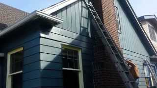 part 2 old seattle home with metal siding painted.