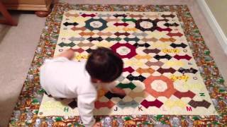 Thomas - Reciting Letters On His Quilt Blanket