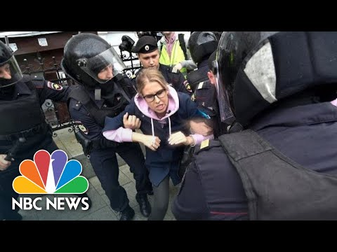 Russian Police Hit Protestors With Batons During Election Rally | NBC News