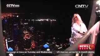 French climber scales Dubai skyscraper