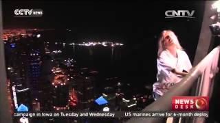 French climber scales Dubai skyscraper