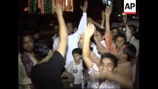 Zardari supporters in night time celebration