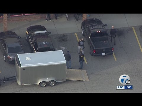 Investigators raid three businesses in Sterling Heights strip mall