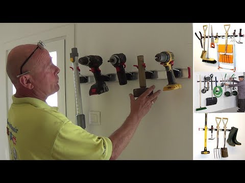 Garage tool wall storage rack drills, hammers, mops brushes Etc