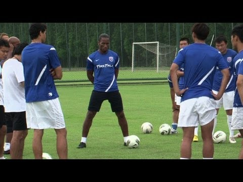 Drogba trains for first time in China