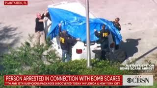 FBI Agents Struggle With Tarp on Mail Bomber's Van