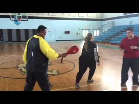 Archbishop Coleman Carroll High School students  kicking paddle Shim Myung Do