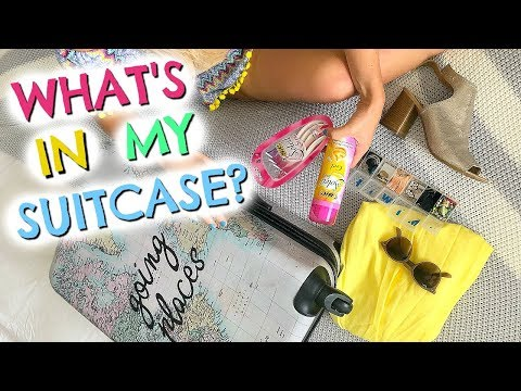 WHAT I PACK IN MY SUITCASE  & MY TRAVEL ESSENTIALS  |  PACK WITH ME  |  EMILY NORRIS AD