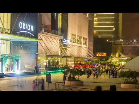 Night time lapse of people moving around orion mall bangalore