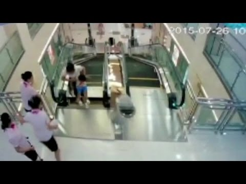 Download Man watches wife die in China escalator accident