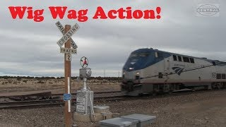 On a cloudy winter afternoon we are on the BNSF Raton Sub in Delhi Colorado. In Delhi is a famous crossing signal which comes to life twice a day. The Wig ...