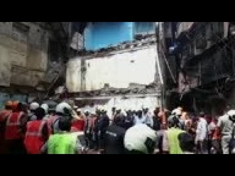 Rescuers find 14 bodies after building collapse