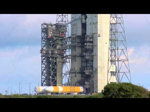 Delta IV Heavy Booster erection for the Orion EFT-1 mission