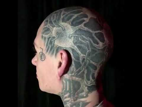 Woman gets tattoo covering half of her face