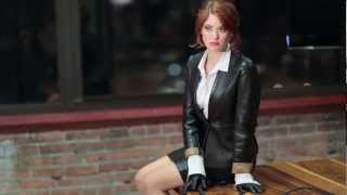 Kelly Kirstein dressed up in leather skirt suit and gloves
