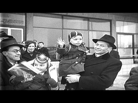 Czech Jewish people, primarily women and children, flee Prague, boarding a plane ...HD Stock Footage