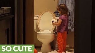 Toddler gets busted dumping toilet paper into toilet