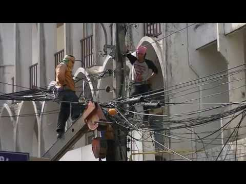 Electricians Climbing on Cables