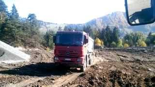 MERCEDES Actros Dump truck unloading dirt in off-road