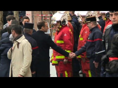 Macron thanks emergency services on return to France