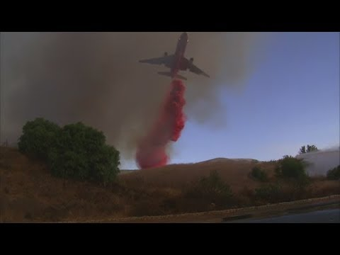 Watch DC-10 jet drop Phos-Chek to control the Anaheim Hills 'Canyon Fire 2' brush fire