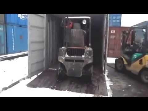 Погрузка товара в контейнер для жд перевозки