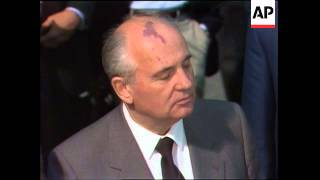 President George H.W. Bush and Soviet Union leader Mikhail Gorbachev make remarks before departing f