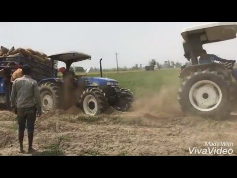 New holland tractor 7500 4wd with trali stuck with 4 New Holland 3630