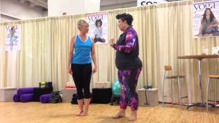 Coach Tulin and Angela Martindale perform CHIYOGAFLOW at Yoga Journal Wellness Studio