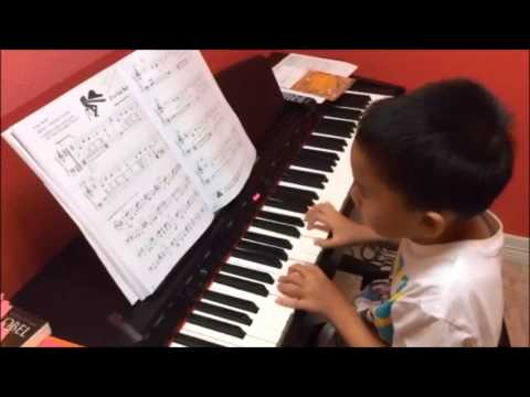 Rhythm Music School Student Playing piano during class (7 years old) Spring, TX