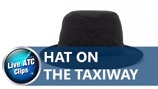ATC@JFK - There's a hat on the taxi way? (by aldo benitez)
