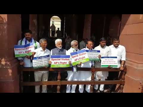YSRCP MPs continued their protest at the entrance of Parliament
