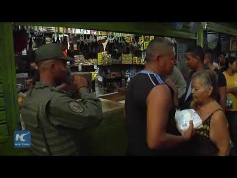 Venezuelan military staffers begin to supervise street sales