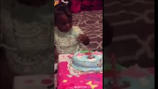 Shina takes a bite of her birthday cake