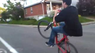 Long Mountain bike wheelie
