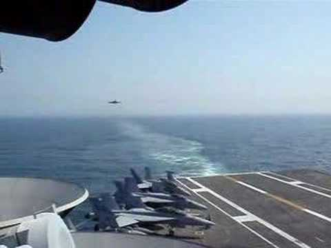 Fighter Jet Landing on Aircraft Carrier