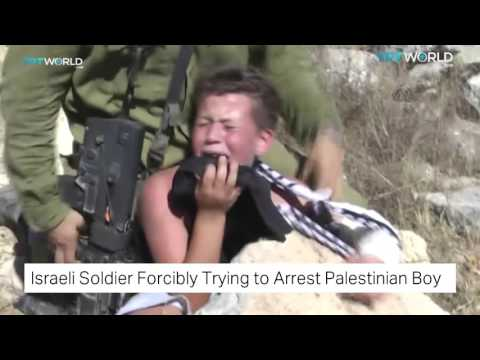 Israeli Forces Try To Arrest A Palestinian Child And Clash With Protestors